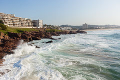 Rocky Coastline Ocean Holiday Apartments Stock Photography
