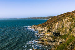 Rocky coastline and ocean waves in Cornwall, UK Stock Image