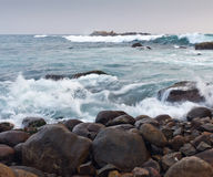 Rocky coastline and ocean waves. The landscape with rocky coastline and ocean waves Royalty Free Stock Images