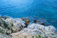 The rocky coastline. Rock in the sea Stock Photography