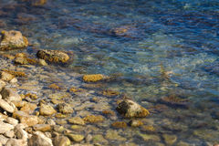 The rocky coastline and rocks under the water Stock Photography