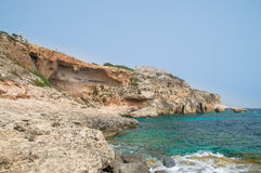 Rocky coastline with Saint Mary`s Battery in Comino Island in Malta. Rocky coastline with Saint Mary`s Battery in Comino Island in Malta Stock Image