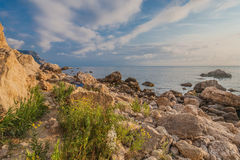 Rocky coastline, sea background Royalty Free Stock Image