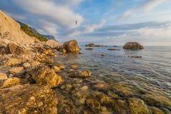 Rocky coastline, sea background Stock Photography