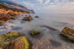 Rocky coastline, sea background Royalty Free Stock Photo