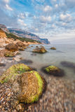 Rocky coastline, sea background Stock Photo