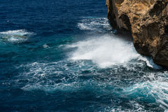Blue hole and the collapsed Azure window. Gozo, Malta. Rocky coastline and sea. Blue hole and the collapsed Azure window in Dwejra Bay, Gozo, Malta Royalty Free Stock Photo