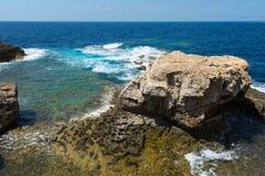 Blue hole and the collapsed Azure window. Gozo, Malta. Rocky coastline and sea. Blue hole and the collapsed Azure window in Dwejra Bay, Gozo, Malta Stock Image