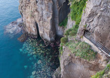 The rocky coastline. The coastline of Sorrento is rocky and forbidding Stock Photos