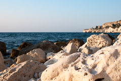 Rocky coastline, stones in sea Stock Images