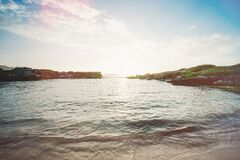 Rocky coastline on sunny day Royalty Free Stock Photo