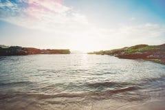 Rocky coastline on sunny day