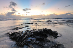Rocky coastline at sunset Stock Image
