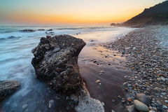 Rocky coastline at sunset Stock Photo
