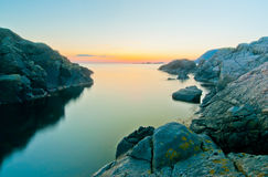 Rocky coastline sunset long exposure Royalty Free Stock Photos
