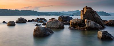 Rocky Coastline. A rocky coastline at sunset looking out over the south China sea in Vung Lam Bay Vietnam Royalty Free Stock Photography