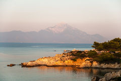 Rocky coastline at sunset Stock Images