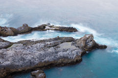 Rocky coastline of Tenerife island with  deep blue water Stock Images