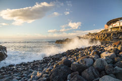 Rocky coastline of Tenerife and splatter at sunset Stock Photography