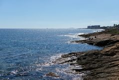 Rocky coastline of Torrevieja. Province of Alicante. Costa Blanc Stock Images
