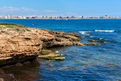 Rocky coastline of Torrevieja. Southern Spain Stock Image