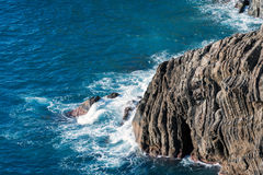 Rocky coastline with transparent blue water at Cinque Terre national par in Italy Stock Images