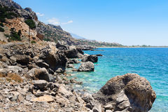 Rocky coastline with turquoise lagoon near Paleochora town on Crete island, Greece Royalty Free Stock Photography