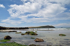 Rocky Cornish coast. A rocky Cornish beach on a sunny day with the tide out Stock Photos
