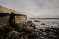 Rocky cove at La Jolla Beach in San Diego. Cloudy day view  of rocky cove at La Jolla Beach in San Diego royalty free stock photos