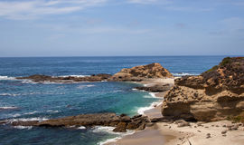 Orange County tropical beach. A jagged cove is a  feature of the cliffs of Orange County in Southern California makes a great snorkeling or swimming spot Stock Photos