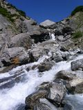 Rocky Creek 3. Creek in the Swiss mountains with huge rocks royalty free stock photography