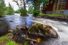 Rocky creek with cascades in Sweden. Rocky creek with cascades in southern Sweden Stock Photo