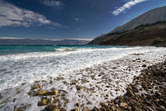 Rocky Croatian beach. A scenic view of a rocky Mediterranean beach on the Island of Krk in Croatia Stock Images
