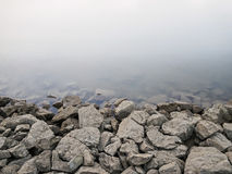 Rocky Dam on River Background Royalty Free Stock Image