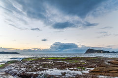 Rocky Dawn Seascape. Early morning on the headland at Pearl Beach, Central Coast, NSW, Australia Stock Photos