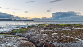 Rocky Dawn Seascape. Early morning on the headland at Pearl Beach, Central Coast, NSW, Australia Stock Image