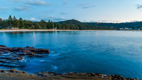 Rocky Dawn Seascape. Looking back to shore at Pearl Beach, Central Coast, NSW, Australia Stock Image