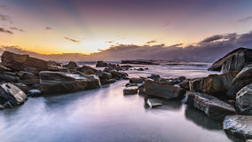 Rocky Daybreak Seascape. The Skillion at Terrigal, Central Coast, NSW, Australia Stock Photo