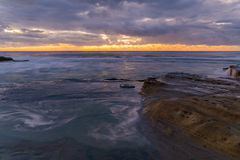 Rocky Daybreak Seascape. Taken at Blue Bay, Central Coast, NSW, Australia Stock Photo