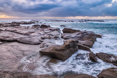 Rocky Daybreak Seascape. Taken at Soldiers Beach, Norah Head, on the Central Coast, NSW, Australia Stock Image
