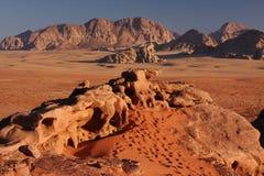 Rocky desert. Rocks and mountains in Jordans Wadi Rum desert, in warm light, a few minutes before sunset Stock Photo