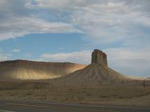 Rocky desert along road Stock Photography