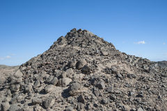 Rocky desert mountain with blue sky background Stock Images