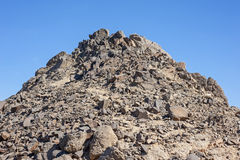 Rocky desert mountain with blue sky background stock image