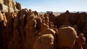 Rocky deserts are scorched by the sun and scoured by windblown sand. Desert rock is shaped into strange, otherworldly lanscapes. Beautiful nature concept stock photo