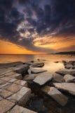 Rocky Dorset Coastline at sunset Stock Image