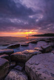 Rocky Dorset Coastline at sunset Stock Photos
