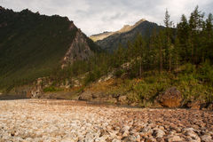 The rocky and dry riverbed in the mountains. Stock Photo