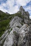 Rocky edge of mountain, mount Catria, Apennines, Marche, Italy. Rocky edge of mountain, blue sky with clouds, Corno of mount Catria, Apennines, Marche, Italy Royalty Free Stock Photos