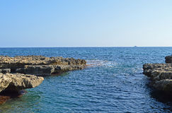A Rocky Entrance To The Sea Royalty Free Stock Images